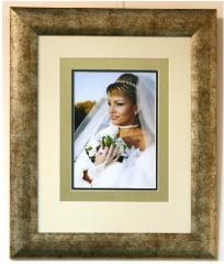 Wedding photos in a wooden frame