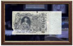 Banknotes in a bagetny frame