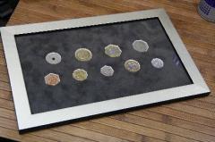 Coins souvenir in a bagetny frame
