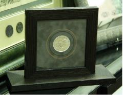 Coins souvenir in a frame from the Italian