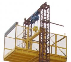 Twin mast climbing work platforms
