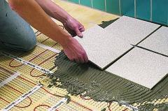 Glues for a tile