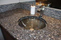 Table-top for a bathroom from Blue Pearl marble