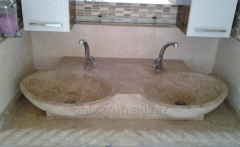 Wash basin from travertine nigh