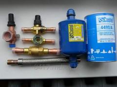 Backpressure spherical valves