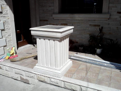 Columns, curbstones, a tile from a natural stone