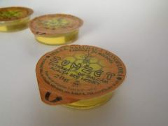 Упаковка мёда в пластиковые стаканчики по 20 гр.
