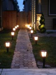 Evening illumination of flower beds and beds